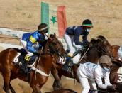 The Wider Image: Meet the teenage Senegalese jockey racing to fame