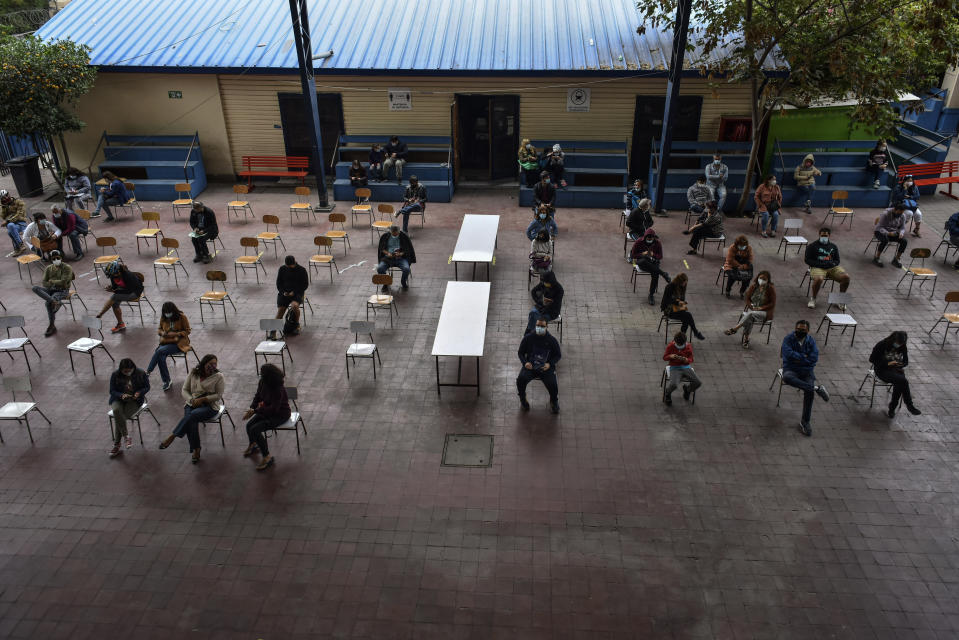 SANTIAGO, CHILE - FEBRUARY 16: Teachers wait to be vaccinated against COVID-19 , at Abdon Cifuentes school for on February 16, 2021 in Santiago, Chile. The vaccination started with teachers and education assistants over the age of 60, in the following days, more than half a million in Chile's education system will be vaccinated. The country has vaccinated almost 2 million people in total according to the Health Ministry and has the highest proportion than any other country in the region. (Photo by Claudio Santana/Getty Images)