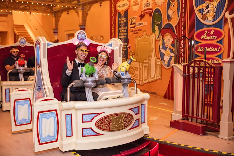After the reception, the newlyweds enjoyed the Toy Story Mania ride. (White Rabbit Photo Boutique)