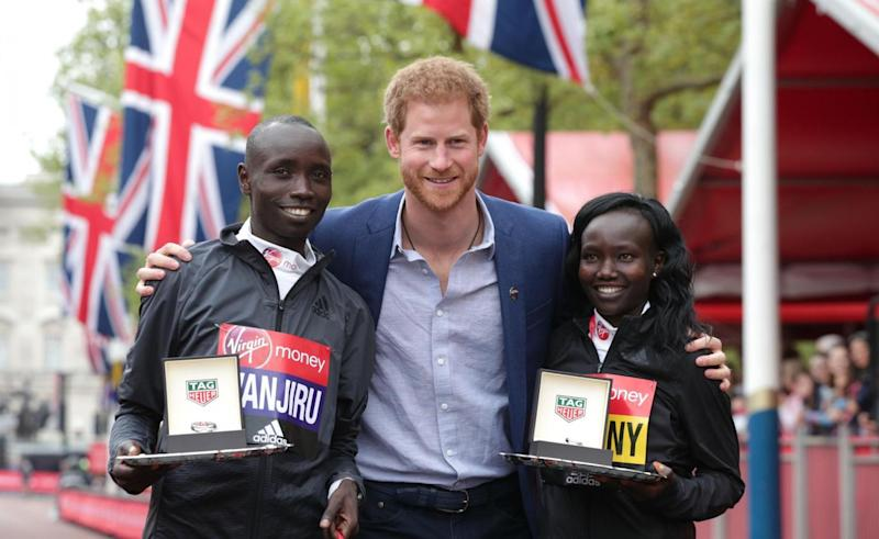 Winners: Prince Harry poses with the winner of the men's elite race, Kenya's Daniel Wanjiru and the winner of the momen's race, Kenya's Mary Keitany(PA)