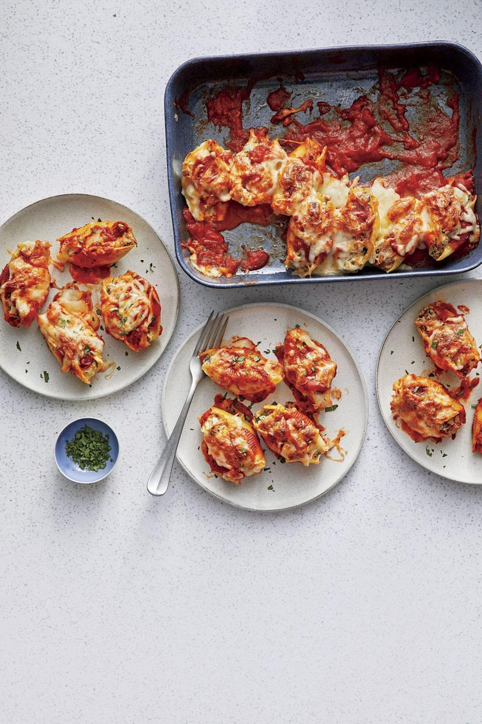 """<p><strong>Recipe: <a href=""""https://www.southernliving.com/recipes/smoked-pork-stuffed-shells"""" rel=""""nofollow noopener"""" target=""""_blank"""" data-ylk=""""slk:Smoked Pork-Stuffed Pasta Shells"""" class=""""link rapid-noclick-resp"""">Smoked Pork-Stuffed Pasta Shells</a></strong></p> <p>Instead of hand-making meatballs for pasta night, drop by your favorite BBQ joint on the way home and pick up some pulled pork to make this hearty supper. Our Test Kitchen has a great tip for freezing this pasta bake without sacrificing a dish: Line the dish with heavy-duty aluminum foil, allowing several inches of foil to extend over sides. Prepare recipe as directed and freeze until firm. Holding the edges of foil, lift the casserole up from the dish, then fold the foil over the top. Wrap tightly in two layers of plastic wrap and re-pop back in the freezer. Before baking, remove plastic wrap, unwrap the top of the frozen casserole and place it back into the baking dish.</p>"""
