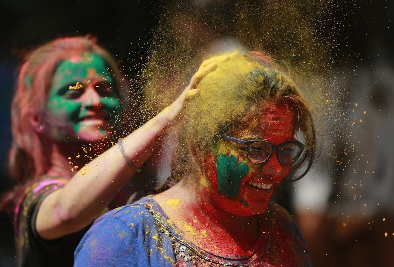 <p>An Indian girl applies colored powder on a her friend as they celebrate Holi, the Hindu festival of colors, in Mumbai, India, Monday, March 13, 2017. The festival also heralds the arrival of spring. (AP Photo/Rafiq Maqbool) </p>