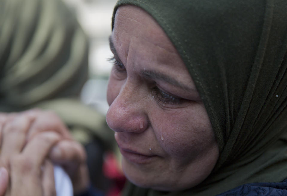 FILE - In this March 21, 2019 file photo, a relative of Palestinian Ahmad Manasra cries during his funeral in the West Bank village of Wad Fokin, near Bethlehem.In August 2020, Israeli military prosecutors offered three months of community service to a soldier who shot and killed Manasra, an unarmed Palestinian man who exited his vehicle to assist a second motorist who had also been shot -- in a case that has drawn renewed attention to a justice system that Palestinians and human rights activists say has created an atmosphere of impunity. The deal is now being reviewed by the Israeli Supreme Court. (AP Photo/Nasser Nasser, File)