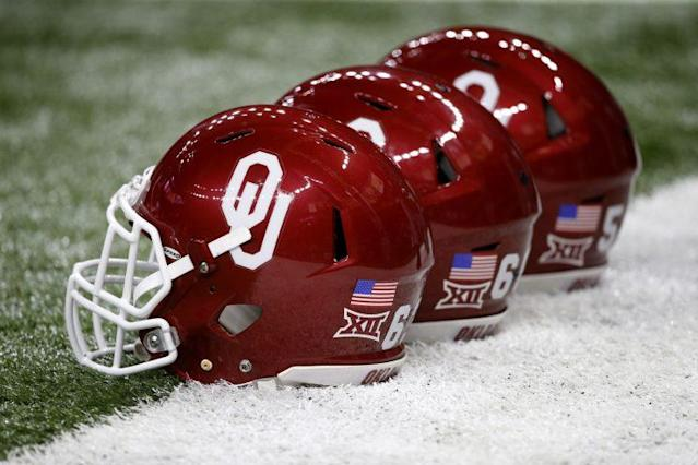 Former Oklahoma DB L.J. Moore, who left the team in 2014, is accused of prostituting a former Sooners cheerleader.
