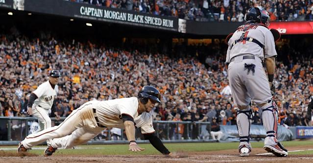 San Francisco Giants' Gregor Blanco slides safely past St. Louis Cardinals catcher Yadier Molina during the second inning of Game 7 of baseball's National League championship series Monday, Oct. 22, 2012, in San Francisco. Blanco scored from second on a hit by Matt Cain. (AP Photo/David J. Phillip)