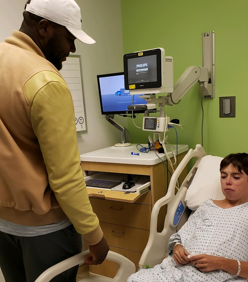 Former Ohio State quarterback Cardale Jones (L) visits Jared Foley in the hospital. The two have formed a bond since Jones' time at OSU. (Credit: Foley family)