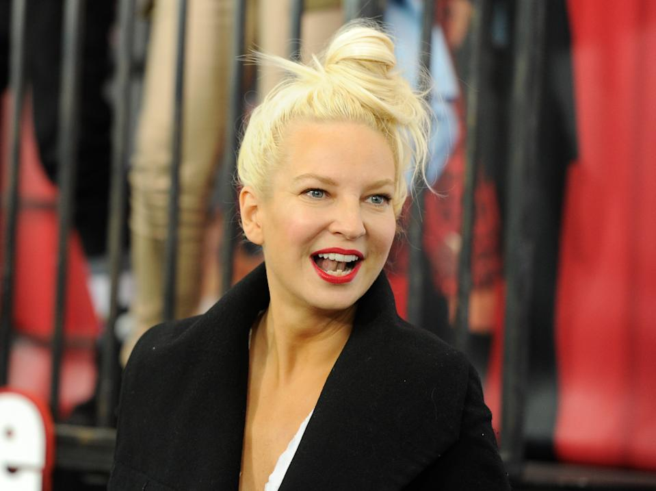 """Singer Sia Furler attends the world premiere of """"Annie"""" at the Ziegfeld Theatre on Sunday, Dec. 7, 2014, in New York. (Photo by Evan Agostini/Invision/AP)"""