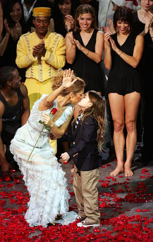"""Celine Dion gives her son Rene-Charles a kiss after the final performance of her Vegas show at Caesars Palace. Ethan Miller/<a href=""""http://www.gettyimages.com/"""" target=""""new"""">GettyImages.com</a> - December 15, 2007"""