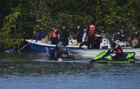 Authorities retrieve the body of 27-year-old Keishla Rodriguez, left, from the San Jose lagoon after she was reported missing in San Juan, Puerto Rico, Saturday, May 1, 2021. A federal judge on Monday ordered Puerto Rican boxer Félix Verdejo held without bail after he was charged in the death of Rodriguez, his pregnant lover. (AP Photo/Carlos Giusti)