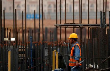A Chinese construction labourer works at the site of the future Iconic Tower skyscraper, at its foundations in the business district, being built by China State Construction Engineering Corp (CSCEC) in the New Administrative Capital (NAC) east of Cairo, Egypt May 2, 2019. REUTERS/Amr Abdallah Dalsh
