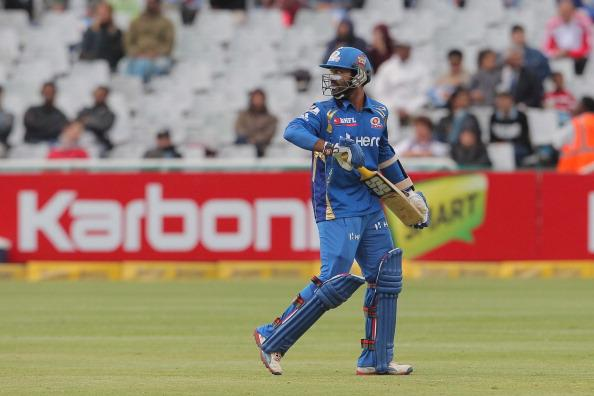 CAPE TOWN, SOUTH AFRCA - OCTOBER 18:  Dinesh Karthik of the Mumbai Indians during the Karbonn Smart CLT20 match between Mumbai Indians (IPL) and Yorkshire (England) at Sahara Park Newlands on October 18, 2012 in Cape Town, South Africa. (Photo by Carl Fourie / Gallo Images /Getty Images)