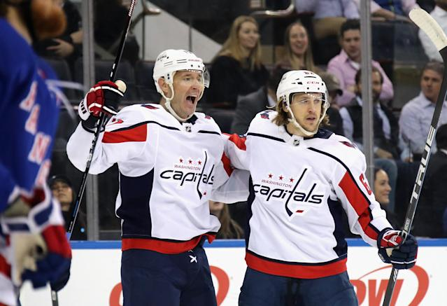 NEW YORK, NEW YORK - MARCH 05: Ilya Kovalchuk #17 of the Washington Capitals (L) celebrates a goal against the New York Rangers and is joined by Carl Hagelin #62 (R) at Madison Square Garden on March 05, 2020 in New York City. The Rangers defeated the Capitals 5-4 in overtime. (Photo by Bruce Bennett/Getty Images)