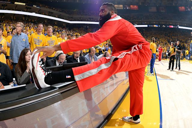 James Harden inspects his kicks to make sure everything's above board.