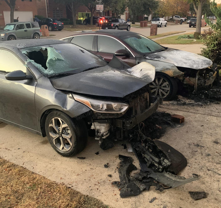 Two cars were set on fire in the driveway. (Jayla Gipson)