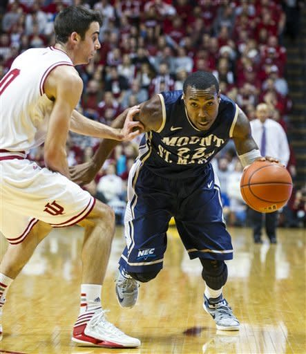 Mount St. Mary's Rashad Whack drives past Indiana's Will Sheehey during the first half of an NCAA college basketball game, Wednesday, Dec. 19, 2012, in Bloomington, Ind. (AP Photo/Doug McSchooler)