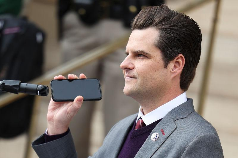 Rep. Matt Gaetz (R-Fla.) holds a phone to the microphone as Donald Trump Jr. speaks remotely to a crowd during a rally against Rep. Liz Cheney (R-WY) on January 28, 2021 in Cheyenne, Wyoming. Gaetz and Trump Jr. added their voices to a growing effort to vote Cheney out of office after she voted in favor of impeaching Donald Trump.