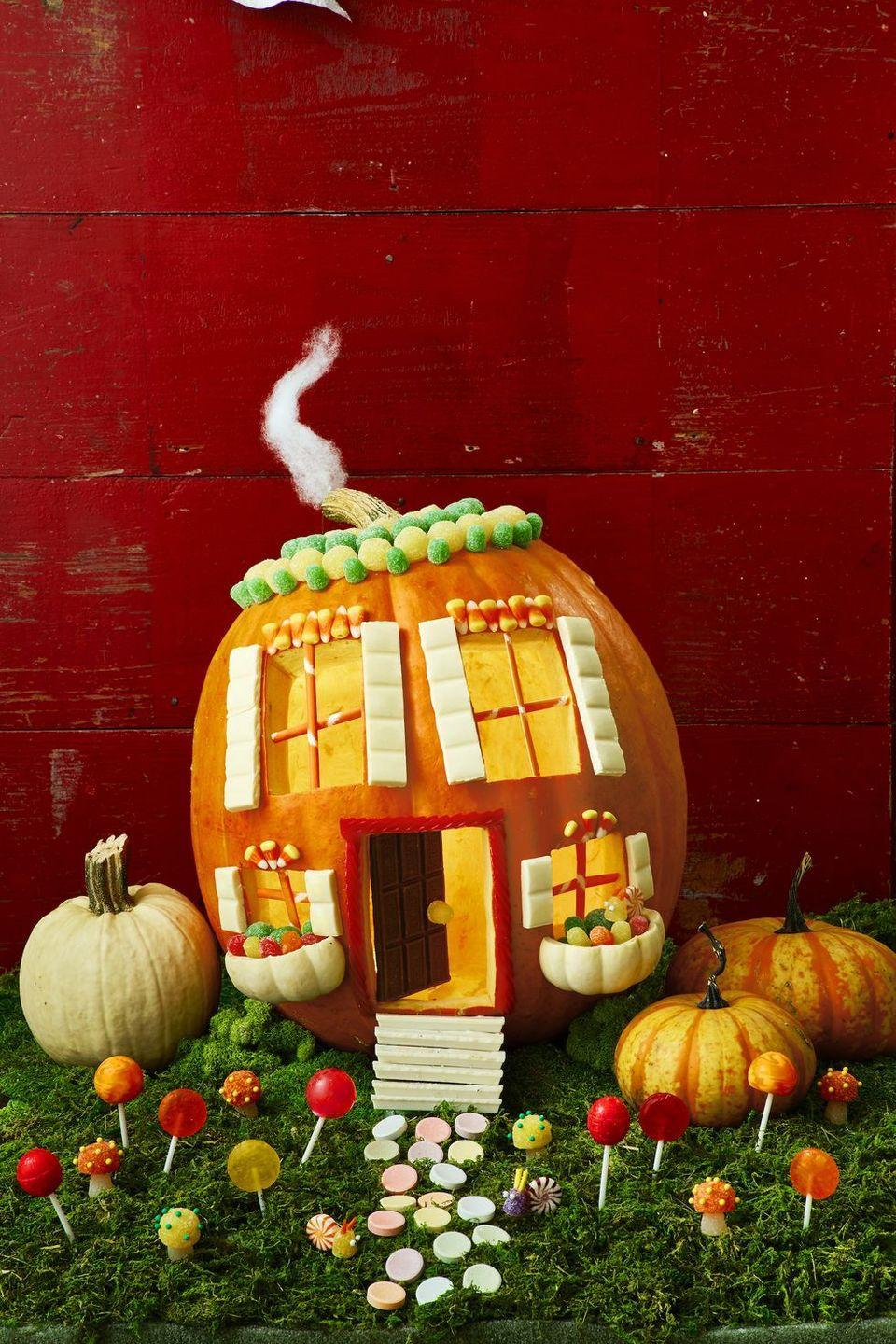 """<p>If there's anything that's a must-do activity for fall, it's carving some pumpkins. Get creative with the best <a href=""""https://www.goodhousekeeping.com/holidays/halloween-ideas/g238/pumpkin-carving-ideas/"""" rel=""""nofollow noopener"""" target=""""_blank"""" data-ylk=""""slk:pumpkin carving ideas"""" class=""""link rapid-noclick-resp"""">pumpkin carving ideas</a> — like this super-fun """"candy land"""" pumpkin dressed up with everything from gum drops to candy corn.</p>"""
