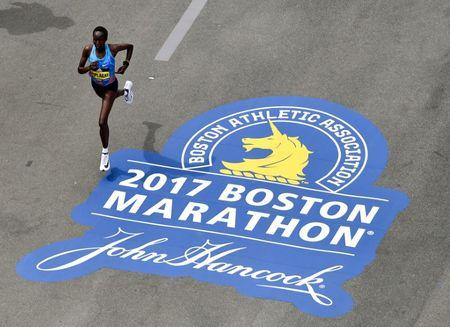 Apr 17, 2017; Boston, MA, USA; Edna Kiplagat runs down Boylston Street towards the finish line of the 2017 Boston Marathon. Kiplagat took first place in the women's division. Brian Fluharty-USA TODAY Sports