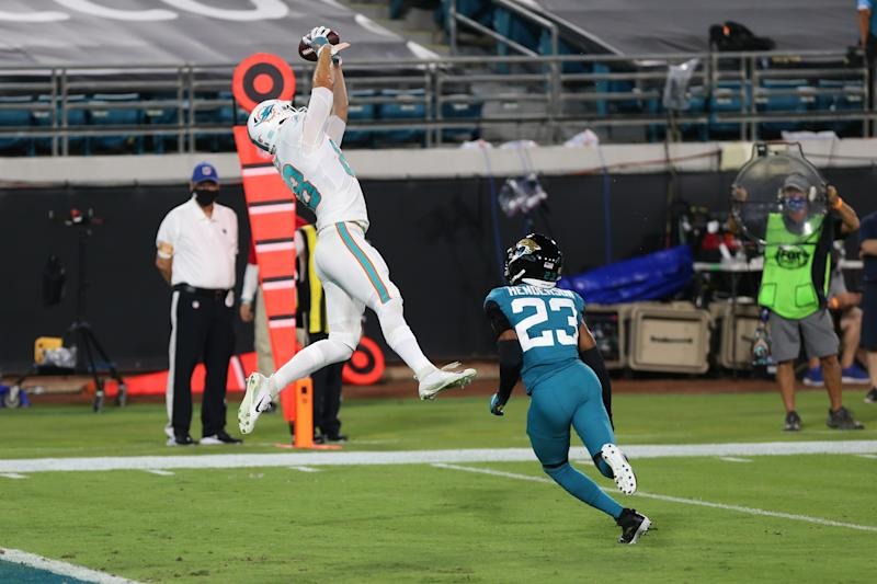 JACKSONVILLE, FL - SEPTEMBER 24: Miami Dolphins Tight End Mike Gesicki (88) catches a pass for a touchdown during the game between the Miami Dolphins and the Jacksonville Jaguars on. September 24, 2020 at TIAA Bank Field in Jacksonville, Fl. (Photo by David Rosenblum/Icon Sportswire via Getty Images)