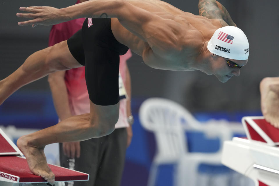Caeleb Dressel of the United States starts in his heat of the men's 100-meter freestyle at the 2020 Summer Olympics, Tuesday, July 27, 2021, in Tokyo, Japan. (AP Photo/Matthias Schrader)