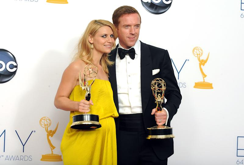 """Actress Claire Danes, winner of the Emmy for outstanding lead actress in a drama series for """"Homeland,"""" left, and actor Damien Lewis, winner of the Emmy for outstanding lead actor in a drama series for """"Homeland"""" pose together backstage at the 64th Primetime Emmy Awards at the Nokia Theatre on Sunday, Sept. 23, 2012, in Los Angeles. (Photo by Jordan Strauss/Invision/AP)"""