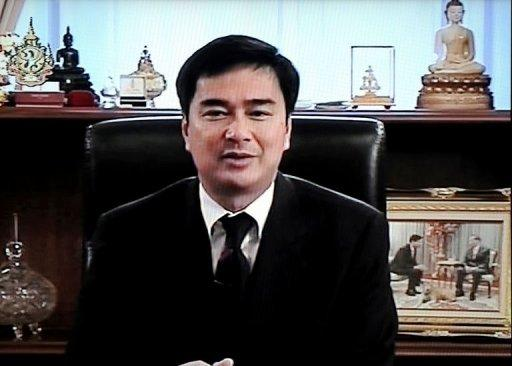 A television grab shows Thai Prime Minister Abhisit Vejjajiva speaking during an announcement of the house dissolution