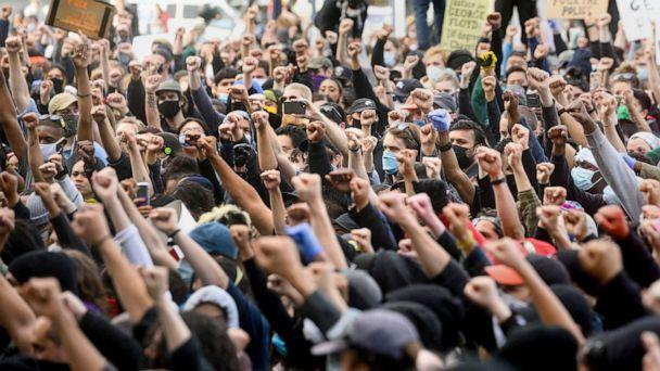 PHOTO: Demonstrators raise their fists during a rally in San Francisco, May 31, 2020, while protesting the death of George Floyd. (Noah Berger/AP)