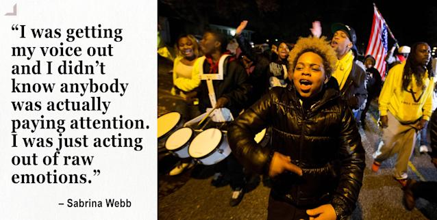 Sabrina Webb, a cousin of Michael Brown, leads a protest near the site where the black 18-year-old was shot and killed by a white police officer in Ferguson. (Photo: David Goldman/AP)
