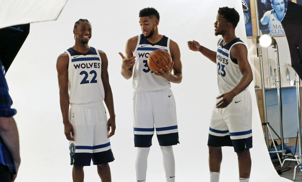 It's a new era in Minnesota with, from left, Andrew Wiggins, Karl-Anthony Towns and Jimmy Butler. (AP)