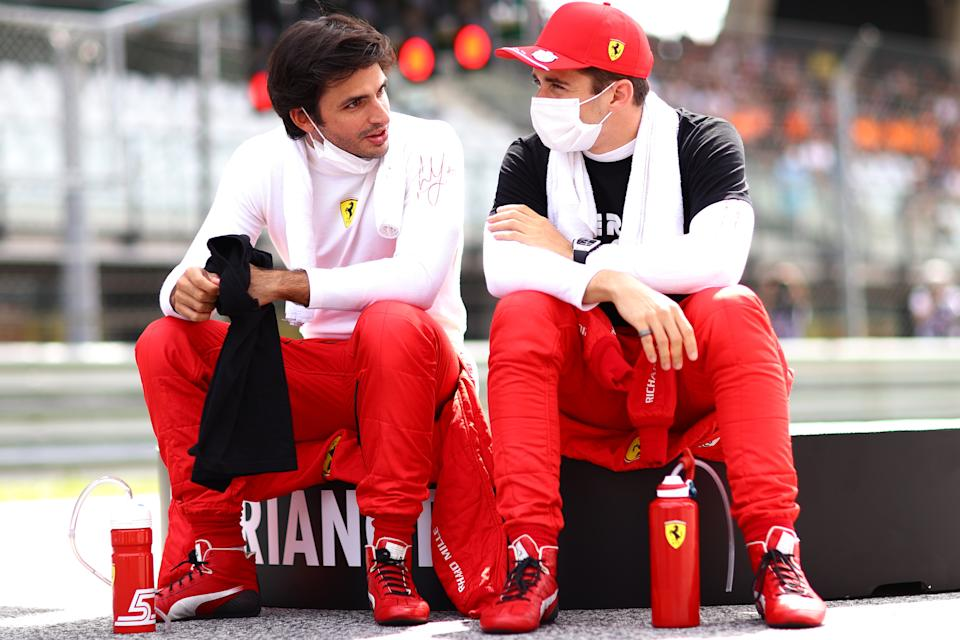 SPIELBERG, AUSTRIA - JUNE 27: Carlos Sainz of Spain and Ferrari and Charles Leclerc of Monaco and Ferrari talk on the grid ahead of the F1 Grand Prix of Styria at Red Bull Ring on June 27, 2021 in Spielberg, Austria. (Photo by Dan Istitene - Formula 1/Formula 1 via Getty Images)
