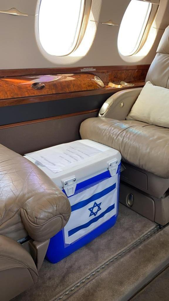 A cooler bearing the Israeli flag sits between seats on a private jet bound for the United Arab Emirates, where in a matter of hours it will be implanted into an ailing Arab mother in Abu Dhabi. The kidney was part of a historic cyclic exchange involving two adults in the UAE and four in Israel, with logistics provided by the Alliance for Paired Kidney Donation, a non-profit based in Toledo, Ohio.