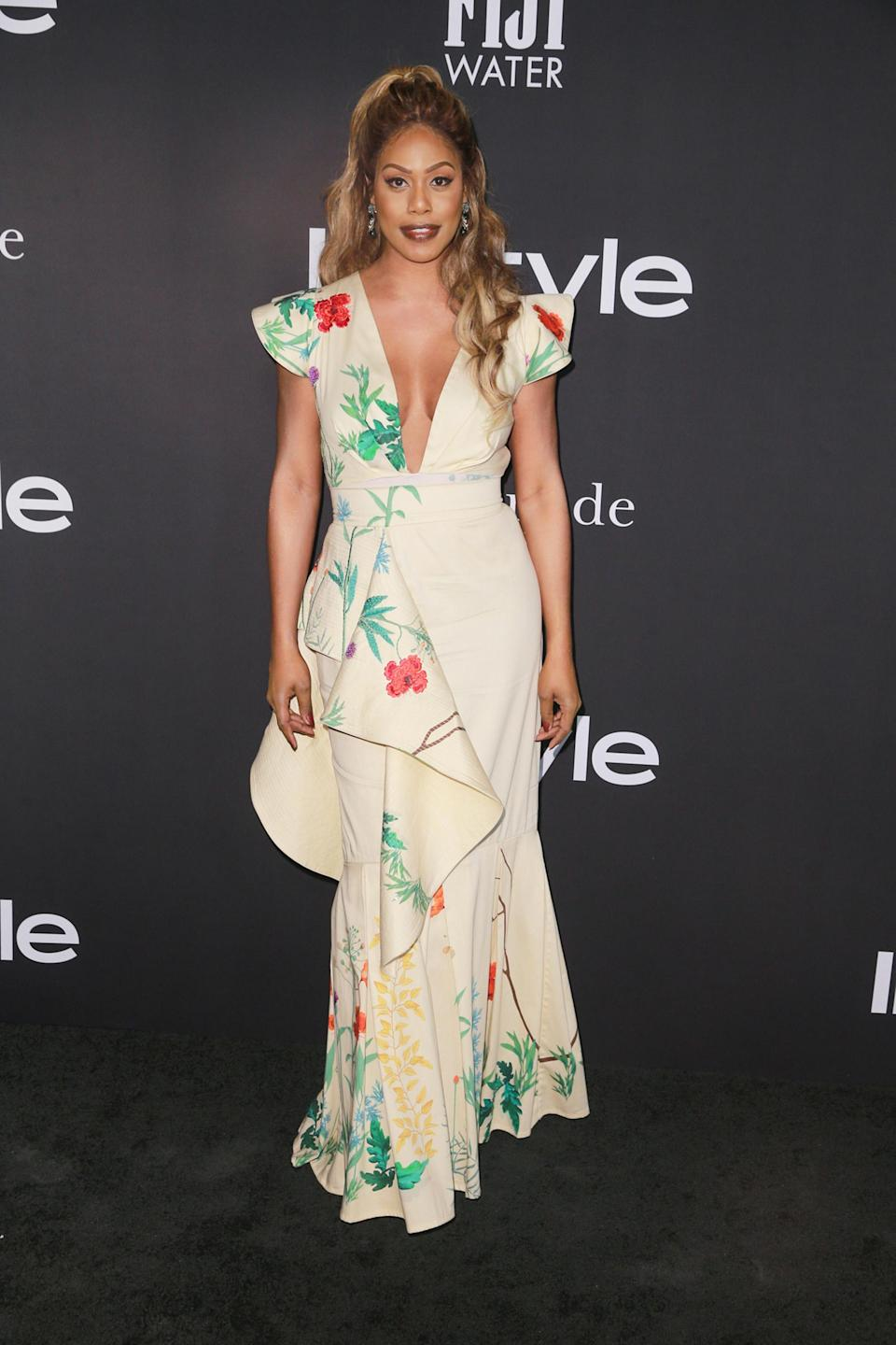 <p>Cox shined in a floral look from Johanna Ortiz. </p>