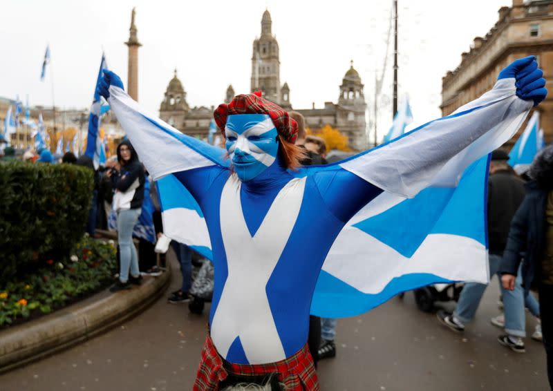 FILE PHOTO: A demonstrator holds a flag during a pro-Scottish Independence rally in Glasgow, Scotland, November 2