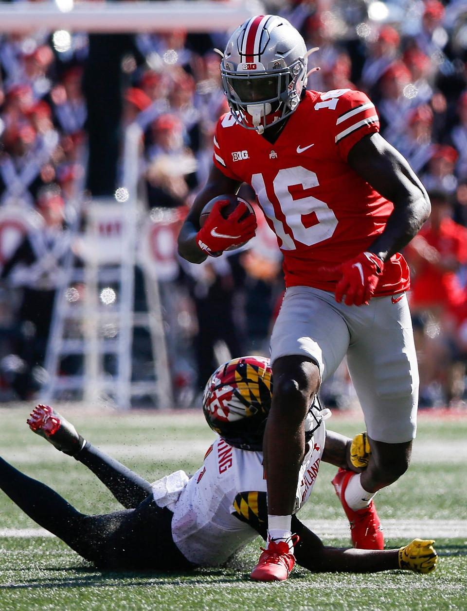 Ohio State Buckeyes cornerback Ryan Watts (16) runs the ball back after an interception during the fourth quarter of a NCAA Division I football game between the Ohio State Buckeyes and the Maryland Terrapins on Saturday, Oct. 9, 2021 at Ohio Stadium in Columbus, Ohio.