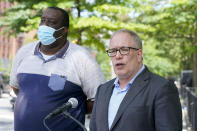 New York City Comptroller and Democratic mayoral candidate, Scott Stringer, right, is joined by the President of the St. Nicholas Houses Association, Tyrone Ball as he speaks to reporters during a campaign news conference, Wednesday, June 9, 2021, in New York. (AP Photo/Mary Altaffer)