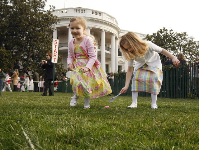 <p>Grace William, 5, left, and Reagan Williams, 6, of Fairfax Station, Va. participate in the annual Easter Egg Roll, Monday, March 24, 2008, on the South Lawn of the White House in Washington. (Photo: Gerald Herbert/AP) </p>