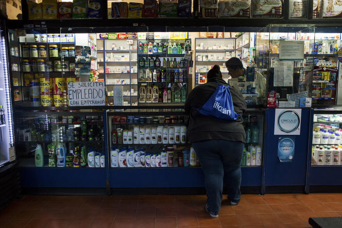<p>A woman suffering from severe obesity buys some medicine at a pharmacy. Mexico has one of the highest overall obesity rates in the world — 32.4 percent, putting it just behind the U.S., although it has at times surpassed it. (Photograph by Silvia Landi) </p>