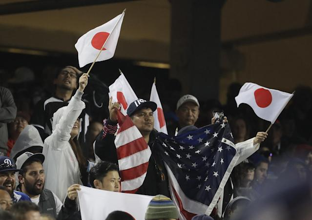 <p>Fans cheer during the eighth inning of a semifinal in the World Baseball Classic between the United States and Japan, in Los Angeles, Tuesday, March 21, 2017. (AP Photo/Chris Carlson) </p>