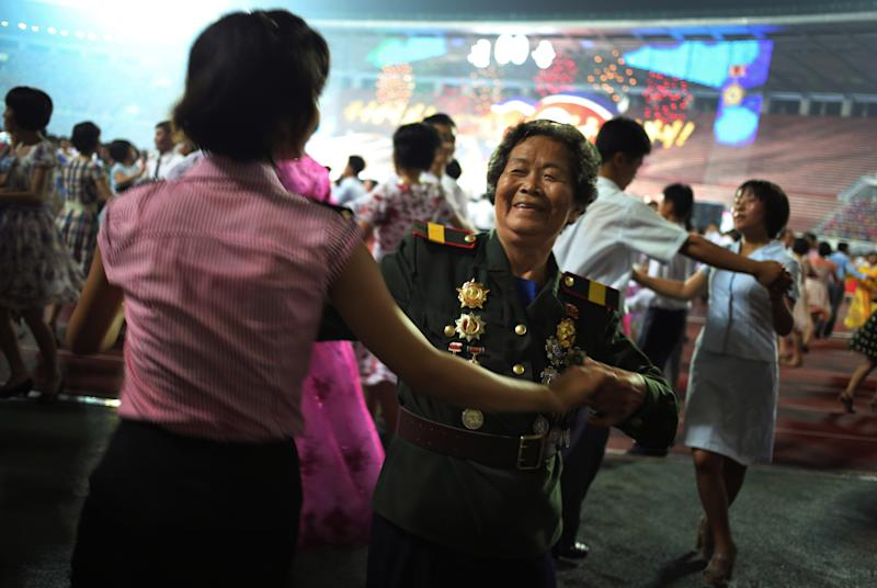 North Korean veteran Oh Gyu Sun, 78, who was a nurse in the Korean War participates in the mass dance party, Sunday, July 28, 2013, during the festivities for the North Korean's celebrations marking the 60th anniversary of the Korean War armistice in Pyongyang, North Korea. (AP Photo/Wong Maye-E)