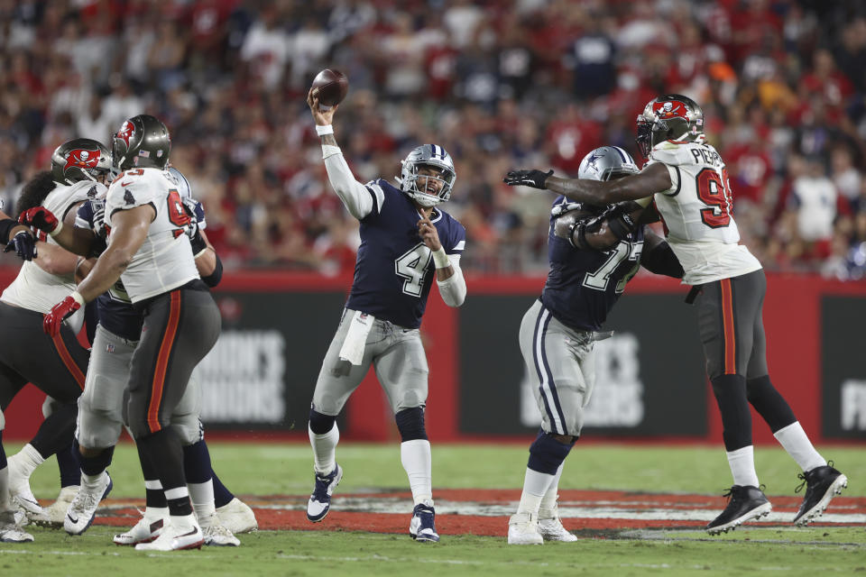 Dallas Cowboys quarterback Dak Prescott (4) throws a pass during an NFL football game against the Tampa Bay Buccaneers, Thursday, Sept 9, 2021 in Tampa, Fla. (AP Photo/Don Montague)