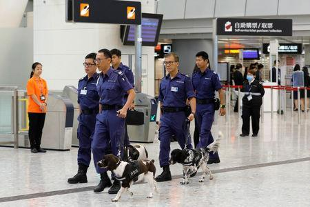 Policemen lead dogs to search West Kowloon terminus, the venue of the opening ceremony of the Hong Kong Section of the Guangzhou-Shenzhen-Hong Kong Express Rail Link, in Hong Kong, China September 22, 2018. REUTERS/Tyrone Siu