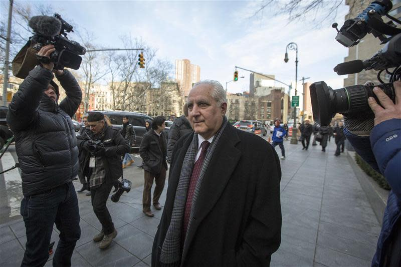 Bonventre, back-office director for Bernard L. Madoff Investment Securities LLC, exits the Manhattan Federal Court house in New York