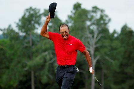 Golf - Masters - Augusta National Golf Club - Augusta, Georgia, U.S. - April 14, 2019 - Tiger Woods of the U.S. celebrates on the 18th hole after winning the 2019 Masters. REUTERS/Brian Snyder