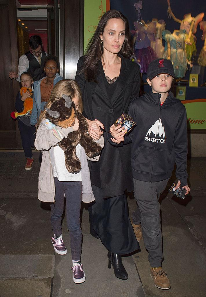 Angelina Jolie was spotted visiting a toy store in London over the weekend with a few of her children. (Photo: XPOSUREPHOTOS.COM)