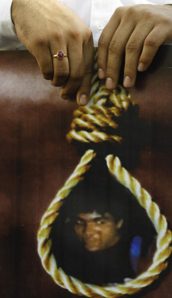 An activist of India's main opposition Bharatiya Janata Party (BJP) holds a portrait of Mohammed Ajmal Kasab with a noose around his neck during celebrations of his execution, in Mumbai, India, Wednesday, Nov. 21, 2012. India executed Kasab, the lone surviving gunman from the 2008 Mumbai terror attack early Wednesday, four years after Pakistani gunmen blazed through India's financial capital, killing 166 people and throwing relations between the nuclear-armed neighbors into a tailspin. (AP Photo/Rafiq Maqbool)
