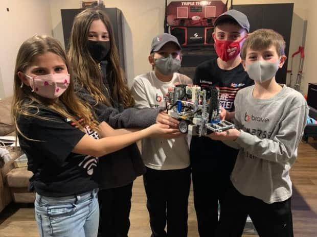 From left to right, McKinley Gallaway, Ava Pepper, Lachlan Gallaway, Adam Foglia and Evan Marier are competing in an international robotics competition known as the Lego League Virtual Open  Invitational. Their team is called the Brave Robots 3000 (Submitted by John Foglia - image credit)