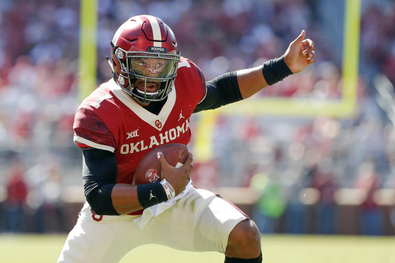 FILE - In this Oct. 19, 2019, file photo, Oklahoma quarterback Jalen Hurts (1) runs against West Virginia during the first half of an NCAA college football game, in Norman, Okla. Hurts was selected to The Associated Press All-Big 12 Conference team, Friday, Dec. 13, 2019. (AP Photo/Alonzo Adams, File)