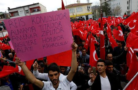 People wave Turkey's national flags during a rally organised by village guards in Cermik