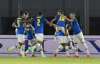 Neymar (wearing number 10) celebrates with his Brazil teammates after opening the scoring against Paraguay