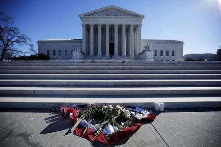 Flowers are seen in front of the Supreme Court building in Washington D.C. after the death of U.S. Supreme Court Justice Antonin Scalia, February 14, 2016. REUTERS/Carlos Barria